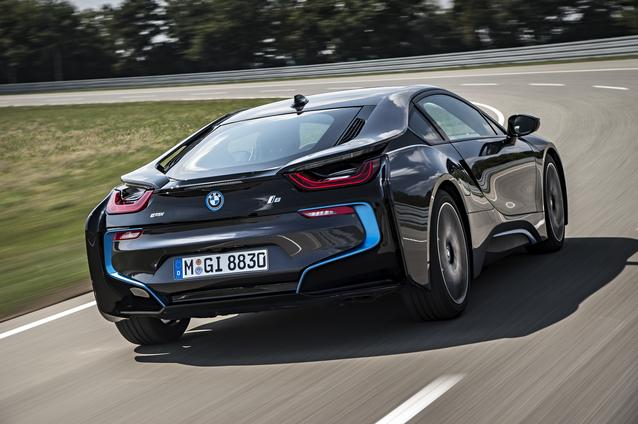 Black-2014-BMW-i8-driving-along-racetrack
